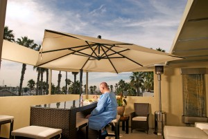 HT patient having lunch on the clinic pent house floor patio with a view of the ocean/the marina