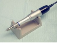 Handheld tools are a sign of a confident and experienced surgeon.